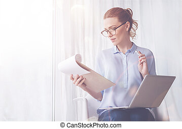 Pleasant woman working at home