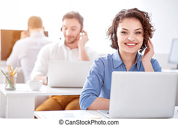 Pleasant woman working in the office