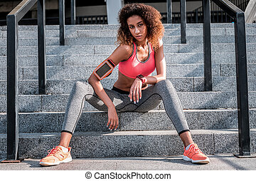 Pleasant young woman resting after a workout