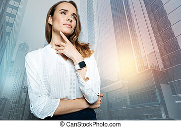 Pleasant young woman thinking about her work