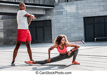 Pleasant young woman working out with her boyfriend