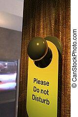 Please do not disturb - Do Not Disturb door hanger on a...