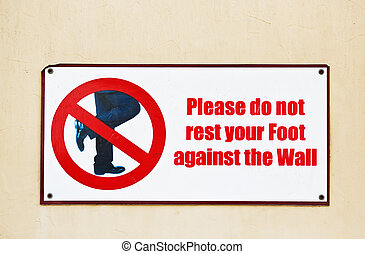 Street sign with restriction. - Please do not rest your feet...