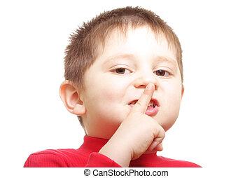 Please dont talk - Closeup photo of boy showing hush gesture