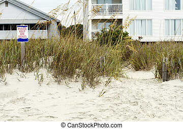 Please Keep Off Dunes Sign and Beach Houses