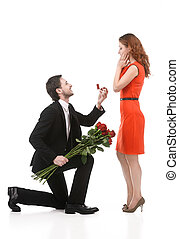 Please, marry me! - Young man in full suit standing on one...