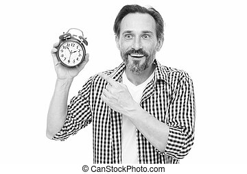 Please observe time. Mature man pointing finger at alarm...