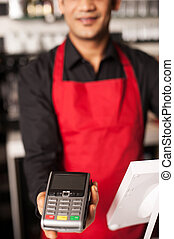 Please swipe your card to process payment - Cropped image of...