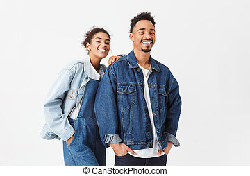 Pleased african couple in denim shirts posing together