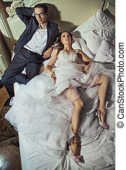 Pleased and happy wedding couple after wedding reception - ...