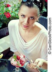 Pleased brunette woman with fine dessert