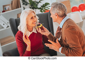 Pleased female person going to eat cake