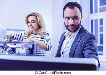 Pleased male person pointing at screen of computer