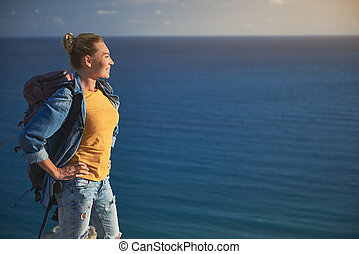 Pleased tourist enjoying view of blew ocean - Profile of...