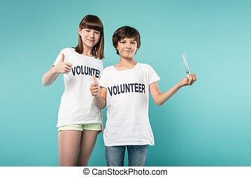 Pleased volunteer holding a plant