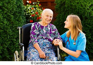 Contented old woman with her kind doctor at the nursing home.