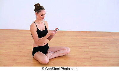 Pleased woman sitting on the floor