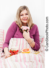 Pleased woman with romantic breakfast