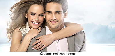 Pleased young guy with his charming girlfriend