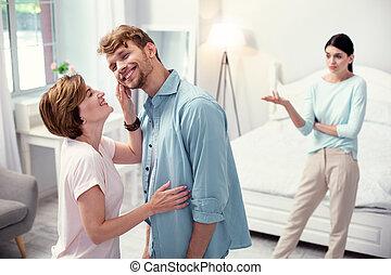 Happy joyful woman looking at her son