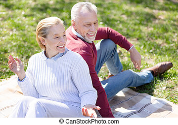 Cheerful delighted couple having a picnic