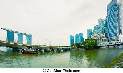 Pleasure boat in the river near bridges. Singapore