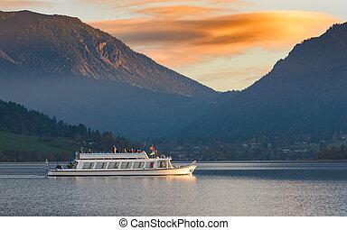 Pleasure boat on Alpine lake in Bavaria