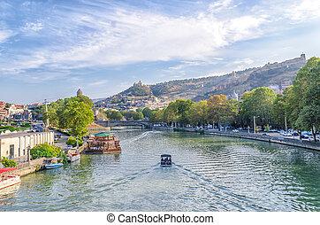 pleasure boat on the waves of the Kura River in Tbilisi Georgia