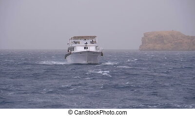 Pleasure Boat with Tourists is Sailing in the Storm Sea on...