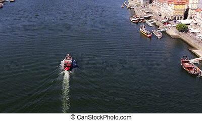 Pleasure boat with tourists sailing on the Douro River in Porto.