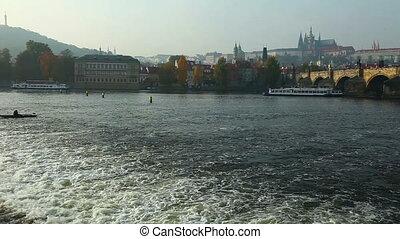 Pleasure boats move on vltava river in Prague