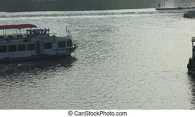 Pleasure boats move on vltava river time lapse