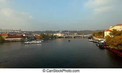 Pleasure boats time lapse on vltava river in Prague