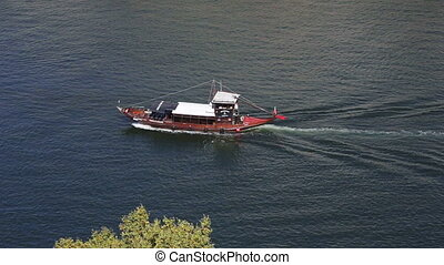 Pleasure boats with tourists sailing on the Douro River in...