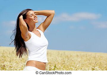 Pleasure - Image of happy female enjoying life on summer day
