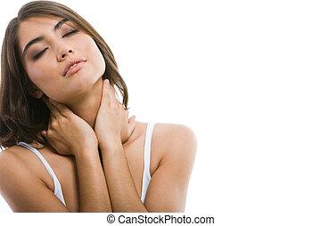Portrait of pretty enjoying woman touching her neck