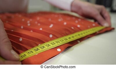 Pleated skirt during measurement in dry-cleaning - Close-up...