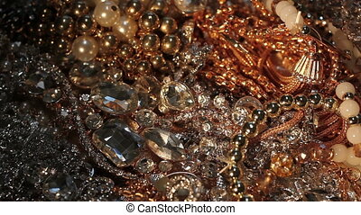 Plenty of various pieces of shining beautiful jewelry. Close-up