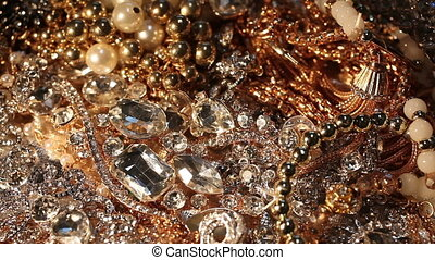 Plenty of various pieces of shining jewelry. Close-up