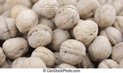 Plenty of walnuts on a table