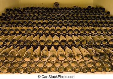 Old wine bottles covered in dust