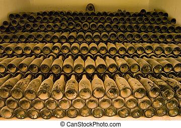 Plenty - Old wine bottles covered in dust