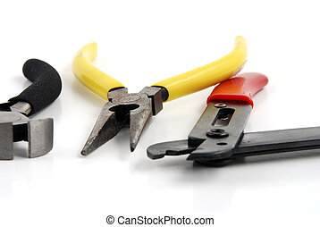 Pliers and wire cutters used for wire work in electronic ...