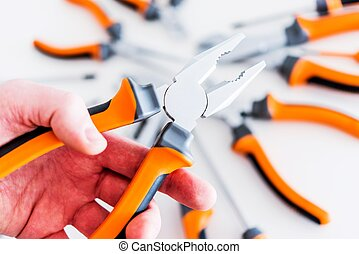 Pliers in a Hand
