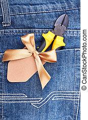 Pliers in blue jeans pocket.