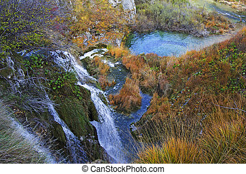 Plitvice Lakes and waterfalls with Autumn colors of National Park in Croatia