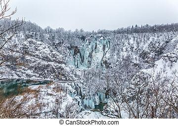 Winter panorama of frozen waterfalls at Plitvice lakes in Croatia.