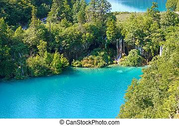 Summer landscape with beautiful waterfalls in the Plitvice Lakes in Croatia