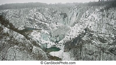 Plitvice lakes waterfall detail - Wide shot of the frozen...