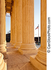 Pllars of Supreme court and US Flag - Late afternoon winter...